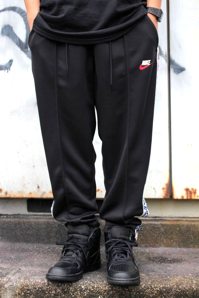 NIKE / NSW TAPED TRACK PANTS / black