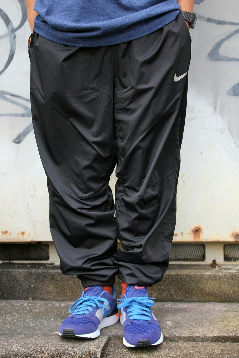 NIKE / LOOSE-FIT TRACK PANTS / black×orange