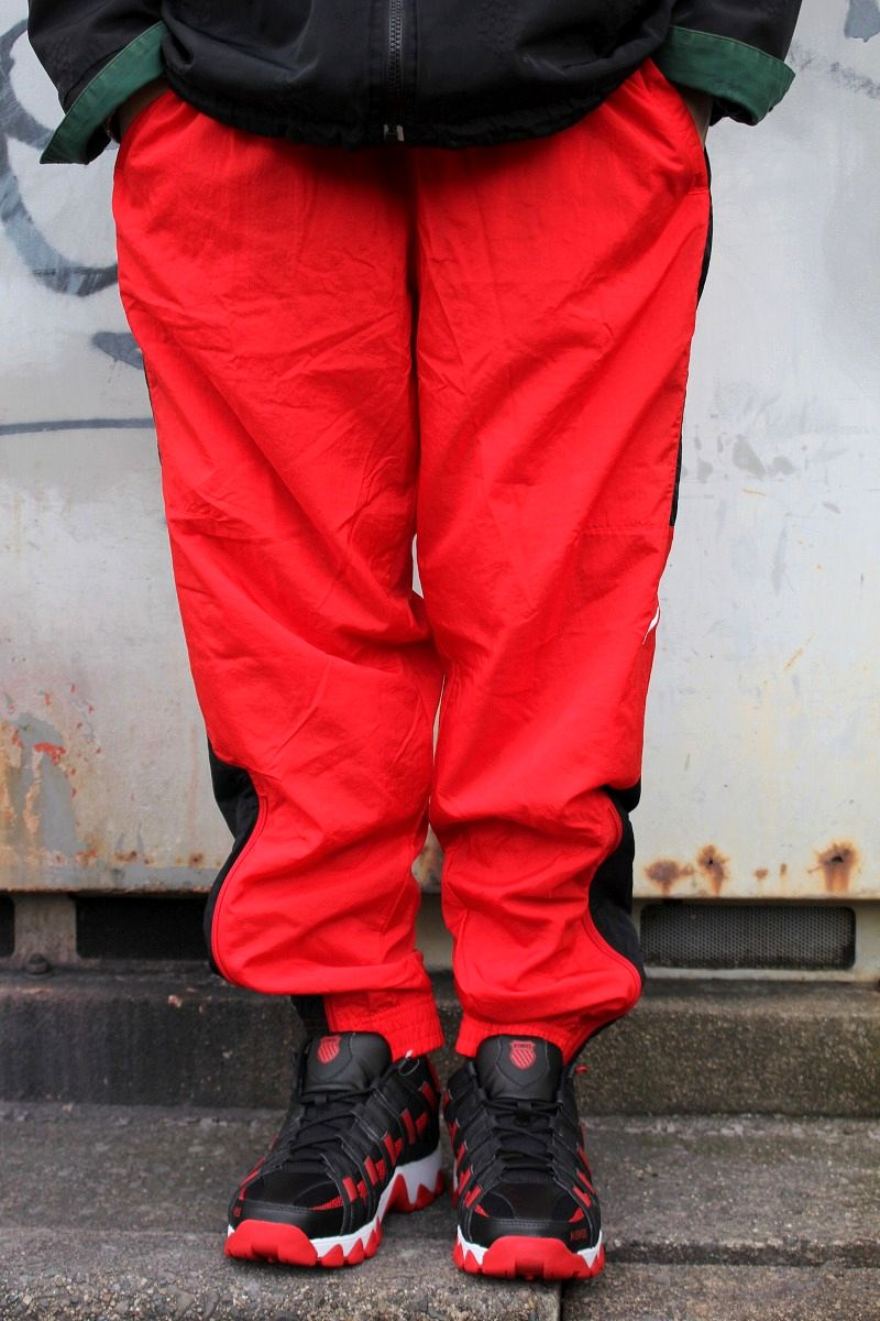 NIKE / STANDARD FIT NYLON TRACK PANTS / red×black